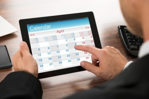 40751886 - close-up of a businessman using calendar on digital tablet in office
